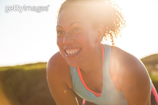 Female jogger resting while out for a run in nature - gettyimageskorea