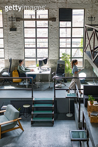 Wide Angle View of a Modern Loft Open Space Office With Businesspeople Working in It - gettyimageskorea