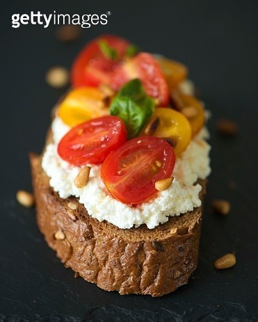 Cherry tomatoes with ricotta on toast - gettyimageskorea