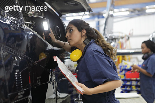 Young female engineers working with helicopters - gettyimageskorea
