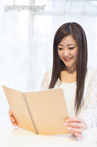 Japanese woman reading a book - gettyimageskorea