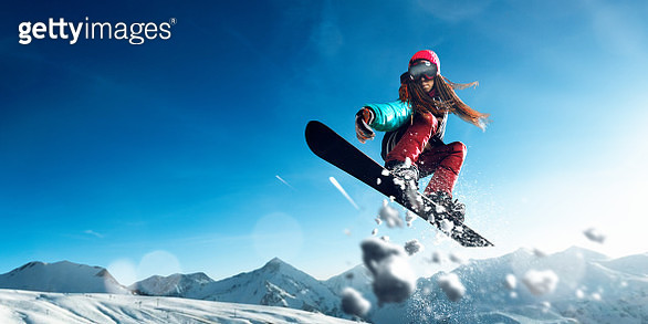 Female extreme freestyle snowboarder jump - gettyimageskorea