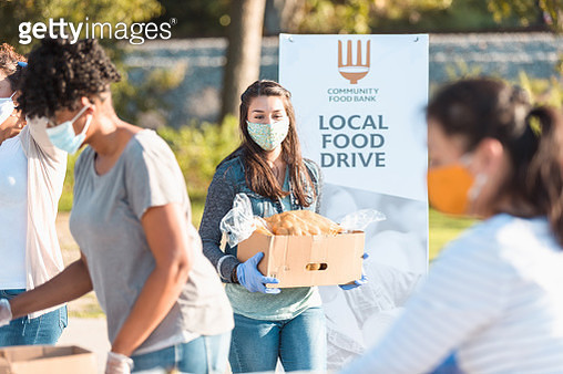 Young woman volunteers at food drive during COVID-19 - gettyimageskorea