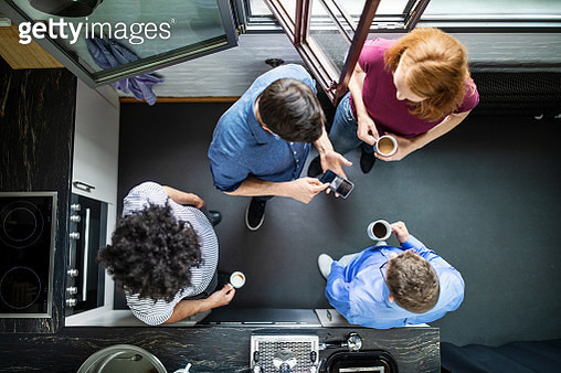 Top view of business people talking during break at office in cafeteria. Group of business professionals standing in cafeteria and talking. - gettyimageskorea