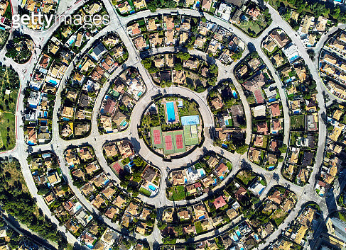 Aerial drone photography residential district Campoamor in the Costa Blanca, view directly from above symmetric round shaped, in the center of circle swimming pool and tennis courts. Alicante Province, Spain - gettyimageskorea