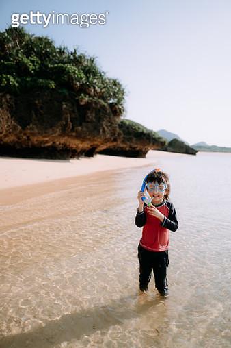 Preschool girl wearing snorkel mask, standing on idyllic tropical beach, Ishigaki Island, Okinawa, Japan - gettyimageskorea