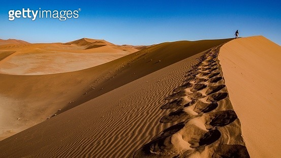 Mid Distance Of Person On Desert Against Clear Sky - gettyimageskorea