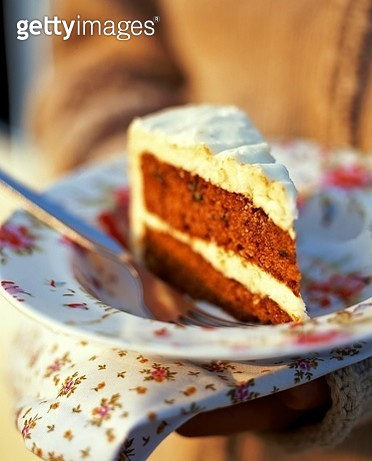 Slice of carrot cake on floral plate - gettyimageskorea