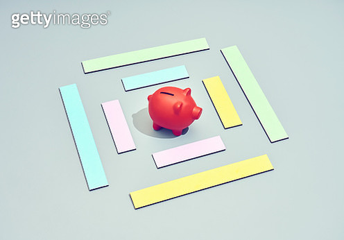 A piggy coin bank with blocks that frames where the money should go - gettyimageskorea