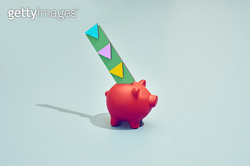 A piggy coin bank with arrows that shows where the money should go - gettyimageskorea