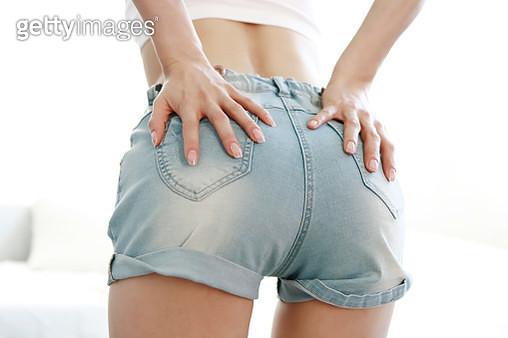 Young woman wearing denim shorts - gettyimageskorea
