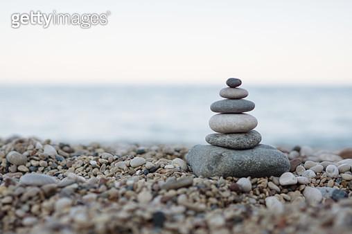 Balanced stones on a pebble beach - gettyimageskorea