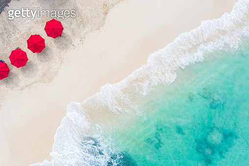 Beach umbrellas and blue ocean. Beach scene from above - gettyimageskorea
