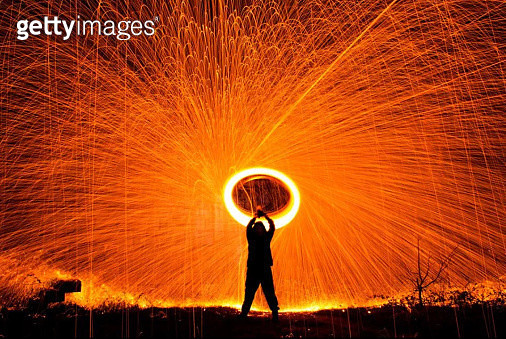 Silhouette Man Spinning Illuminated Wire Wool At Night - gettyimageskorea