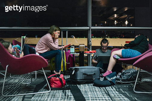 Family waiting in airport - gettyimageskorea