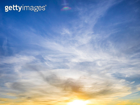 Full frame of the low angle view of clouds of colors blue and orange in sky during sunset. - gettyimageskorea