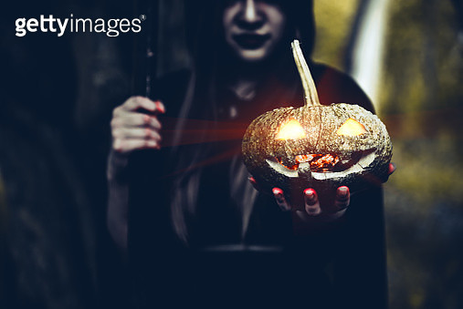 Midsection Of Woman In Witch Costume Holding Illuminated Jack O Lantern - gettyimageskorea