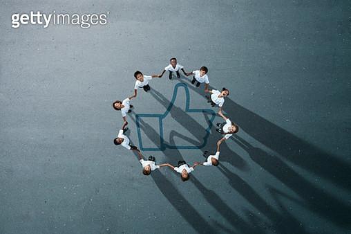 School children in uniforms standing in circle & holding hands - gettyimageskorea