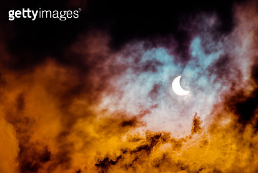 Partial annular solar eclipse, known in such circumstances as a ring of fire, seen in Malaysia in 26th Dec 2019. Cloudy weather in the Kuala Lumpur obscuring much of the view. Dramatic colour applied. - gettyimageskorea