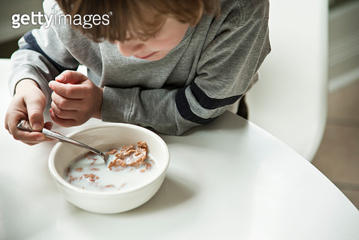 Boy eating bowl of cereal - gettyimageskorea