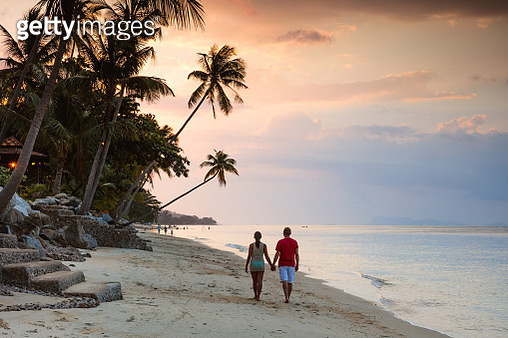 Adult couple on tropical beach at sunset, Ko Samui, Surat Thani province, Thailand - gettyimageskorea