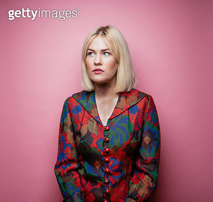 Blond woman wearing multi-colored coat - gettyimageskorea