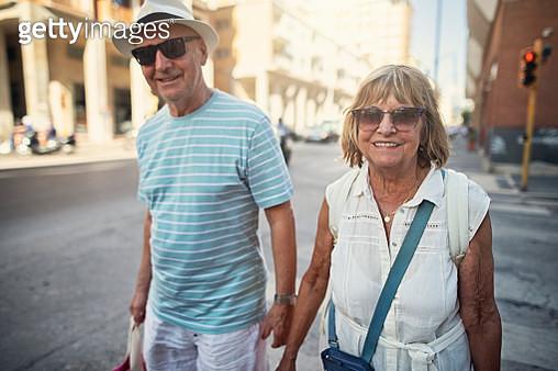 Happy senior couple is sightseeing Salerno. The couple is walking the street. Nikon D850 - gettyimageskorea