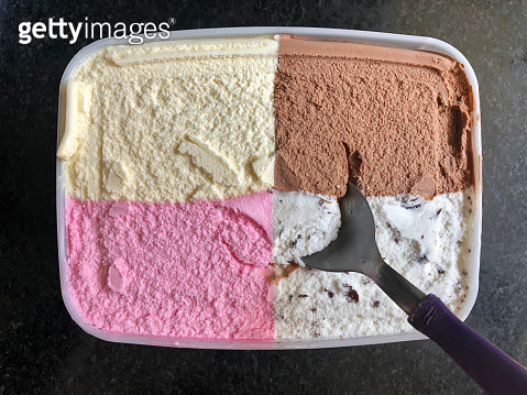 Ice cream jar with 4 flavors. Strawberry, Vanilla, chocolate and flakes. - gettyimageskorea