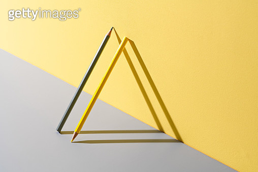 Yellow and Gray Pencils Leaning on Yellow and Gray - gettyimageskorea