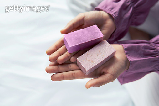 Handmade lavender soap in a woman palm - gettyimageskorea
