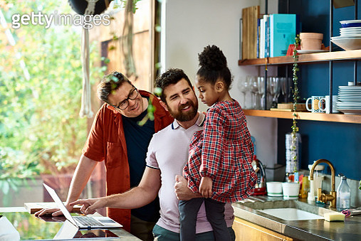 Gay couple online shopping with their daughter - gettyimageskorea