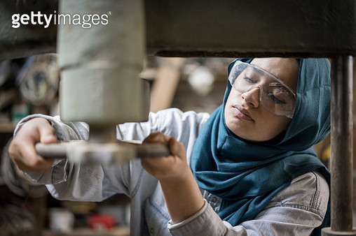 Muslim girl is working small family carpenter factory - gettyimageskorea