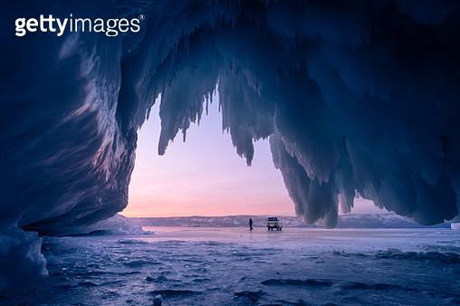 Ice cave in Baikal frozen lake in winter season at beautiful sunset, Olkhon island, Siberia, Russia, Asia - gettyimageskorea