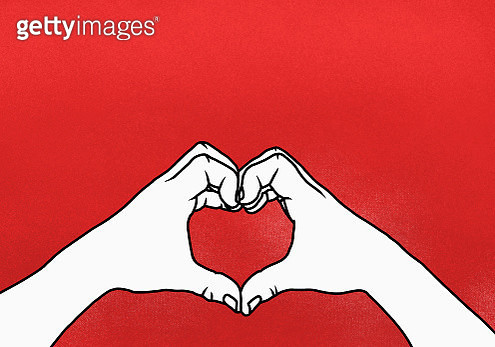 Cropped hands of person making heart shape against red background - gettyimageskorea
