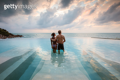 Tourist couple in an infinity pool at sunset, Ko Samui, Surat Thani province, Thailand - gettyimageskorea