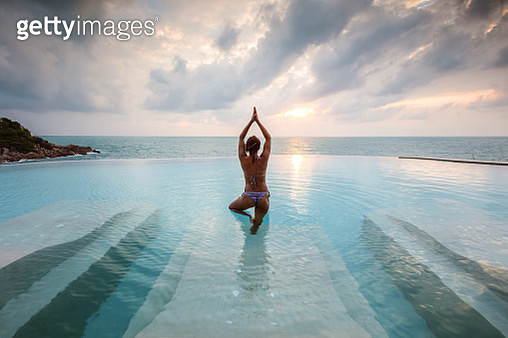 Asian woman in an infinity pool at sunset, Ko Samui, Surat Thani province, Thailand - gettyimageskorea