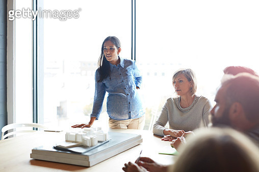 Pregnant woman presenting architectural model - gettyimageskorea