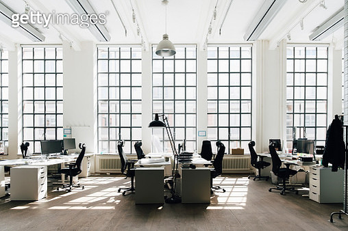 Empty table and chair against window at new workplace - gettyimageskorea