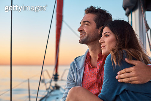 Shot of a young couple enjoying a cruise out on the ocean - gettyimageskorea