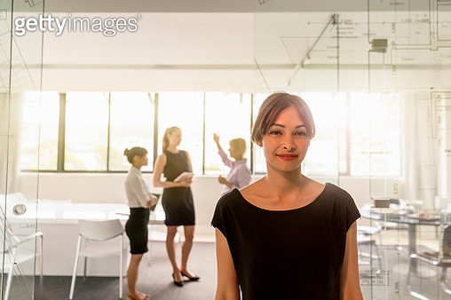 Portrait of smiling businesswoman in office - gettyimageskorea