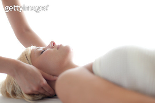 Woman receiving a massage at a spa. - gettyimageskorea