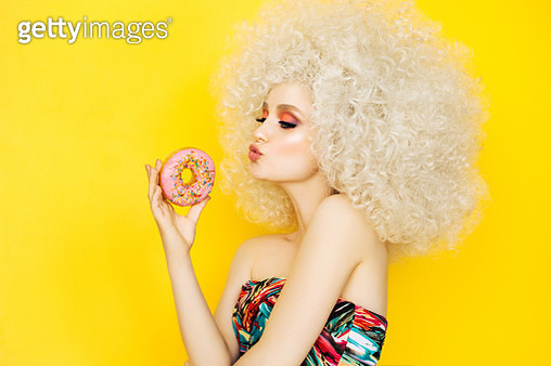 Pretty blonde with pink donuts - gettyimageskorea