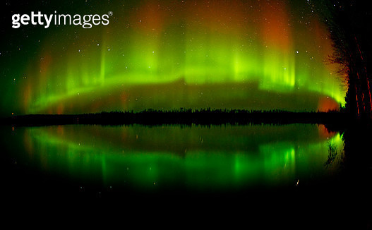 Reflection of Milky Way and aurora borealis in lake, Longlac, Ontario, Canada - gettyimageskorea