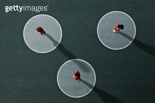 Group of children photographed from above on various painted tarmac surface at sunset - gettyimageskorea