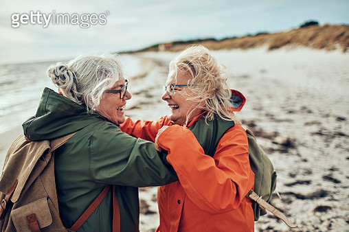 Seniors walking by the beach - gettyimageskorea