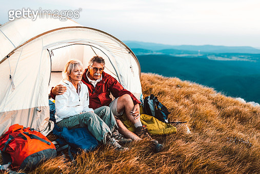 Happy senior couple camping in the mountains - gettyimageskorea
