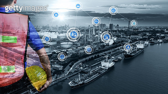 Double exposure of Engineer with safety helmet with oil and gas refinery industry plant background, Industry 4.0 concept, Smart factory solution and Internet of things network - gettyimageskorea