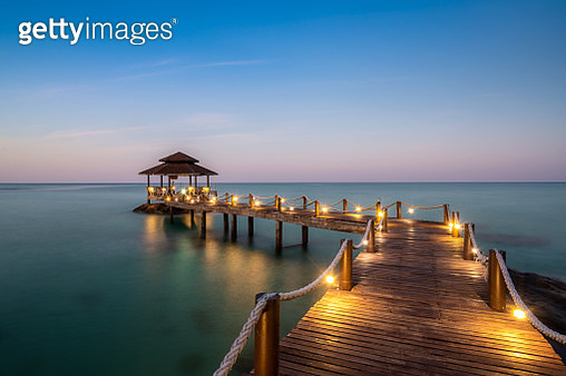 Wooden bar in sea and hut with night sky in Koh Kood at Trat, Thailand. Asia Summer, Travel, Vacation and Holiday concept. - gettyimageskorea
