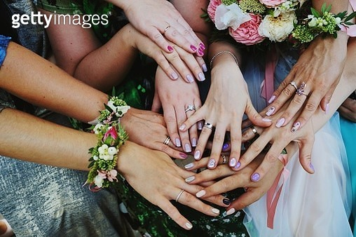 Midsection Of Friends And Bride Joining Hands At Wedding - gettyimageskorea