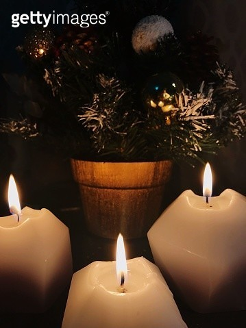 Lit Candle By Christmas Tree - gettyimageskorea